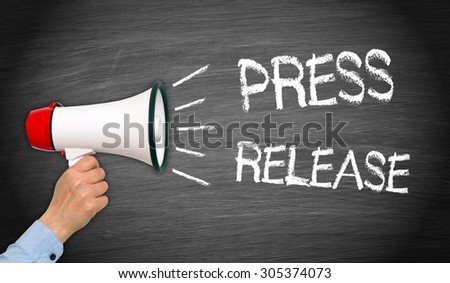 Press Release - female hand with megaphone and text - stock photo