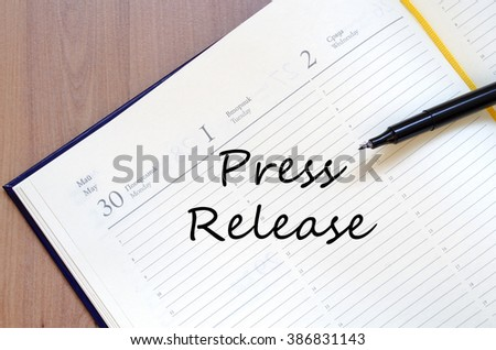 Press release text concept write on notebook with pen - stock photo