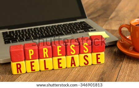 Press Release written on a wooden cube in a office desk - stock photo