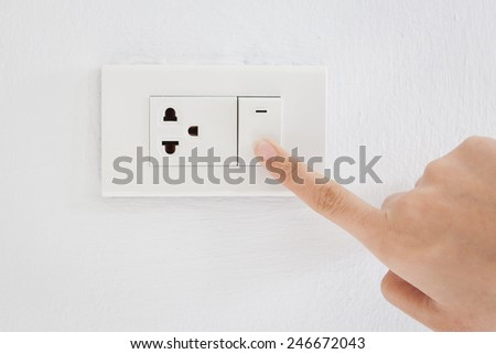 Press turn off electrical switch - stock photo