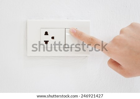 Press turn on electrical switch - stock photo