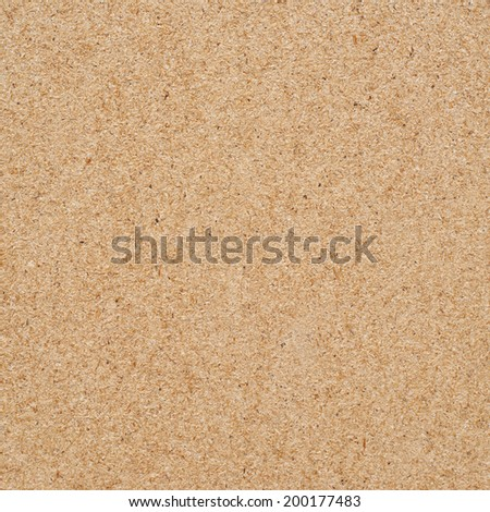 Pressed wood fibers material fragment as a background texture - stock photo
