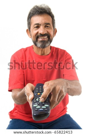 Pressing a button of the remote control . - stock photo