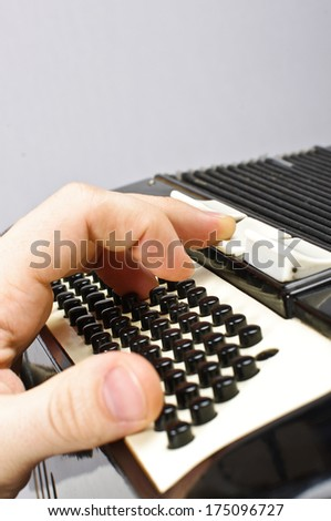 Pressing accordion buttons - stock photo