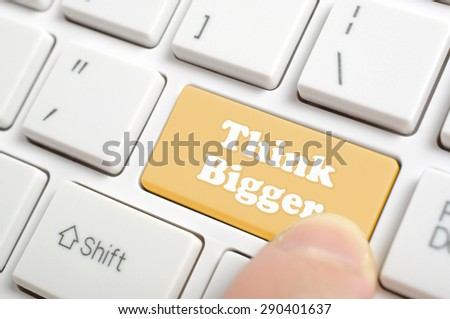 Pressing brown think bigger key on keyboard - stock photo