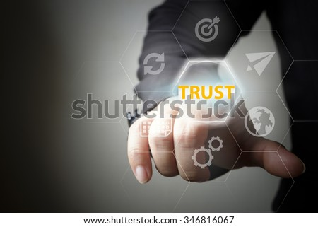 pressing button touch screen interface and select TRUST. business concept , business idea - stock photo