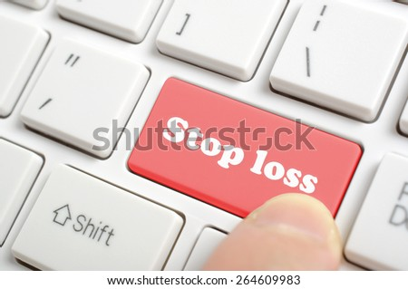 Pressing red stop loss key on keyboard - stock photo