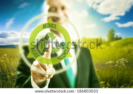 Pressing virtual screen selecting recycle symbol, clean technology - stock photo