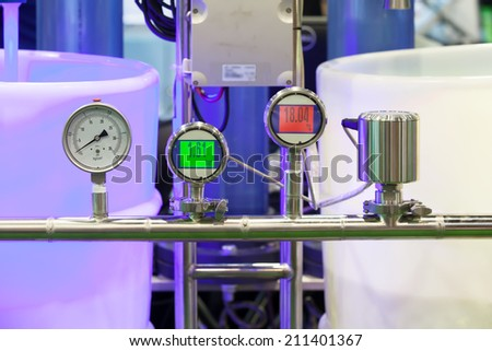 Pressure Guage and Digital Pressure Guage in an industrial line - stock photo