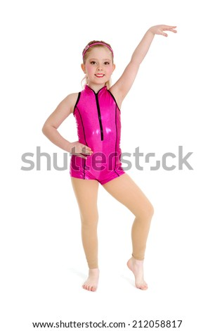 Preteen Acro Jazz Dancer Poses in Pink Recital Costume on White Background - stock photo