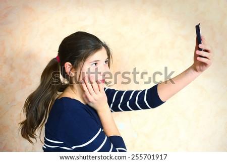 preteen beautiful girl make selfie - stock photo