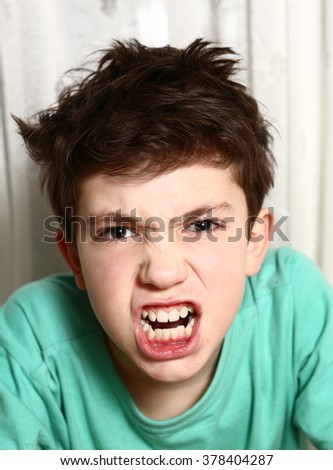 preteen boy in anger rage emotional closeup portrait - stock photo