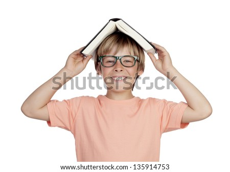 Preteen boy with a book and glasses isolated on white background - stock photo