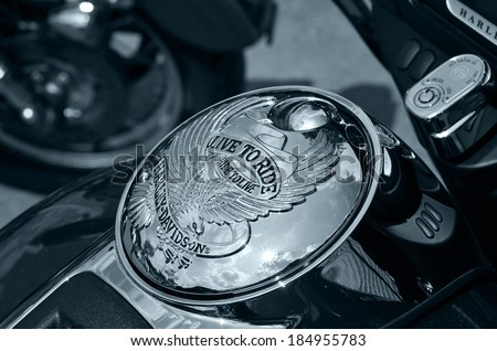 PRETORIA, SOUTH AFRICA - MARCH 29, 2014: Famous Ride to live logo on a Harley Davidson motorcycle in black and white. - stock photo