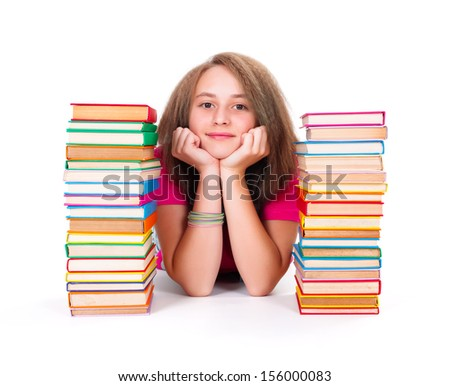 Pretty adolescent girl between bunch of colorful books smiling kindly - stock photo