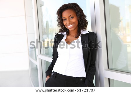 Pretty african american business woman at office building - stock photo