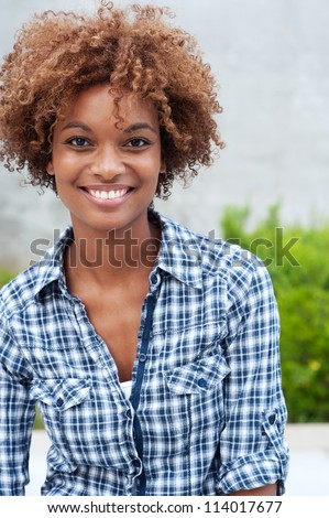 pretty african american college student on campus - stock photo