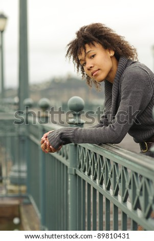Pretty African American girl stand on pier of San Francisco embankment - stock photo