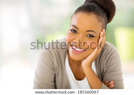 pretty african american woman looking at the camera - stock photo