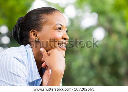 pretty african american woman relaxing outdoors - stock photo