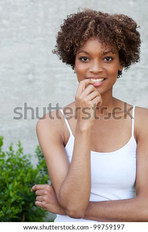 pretty African American woman standing outside - stock photo