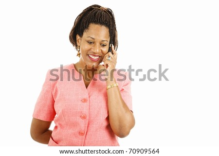 Pretty african-american woman talking on her mobile phone.  Isolated on white. - stock photo
