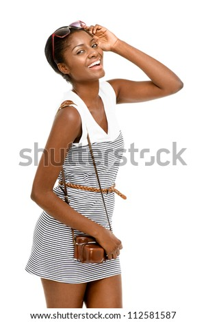 Pretty African American woman wearing vintage dress holding camera isolated on white background - stock photo