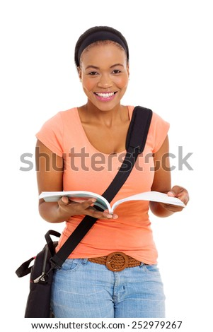 pretty african female college student reading a book - stock photo