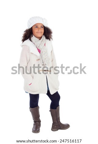 Pretty african girl looking up with winter clothes isolated on a white background - stock photo