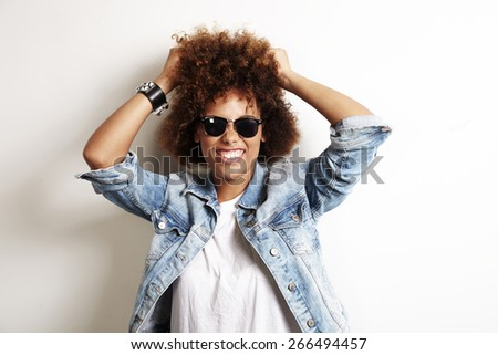 pretty african woman have fun with her curly hair - stock photo