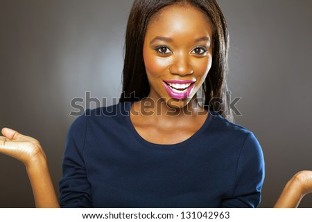 pretty african woman looking surprised - stock photo