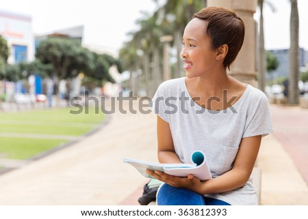 pretty afro american college girl outdoors looking away - stock photo