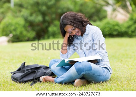 pretty afro american university student studying outdoors - stock photo