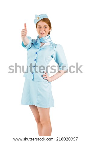Pretty air hostess with hand on hip on white background - stock photo