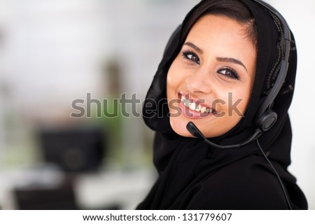 pretty Arabian call center operator closeup portrait - stock photo