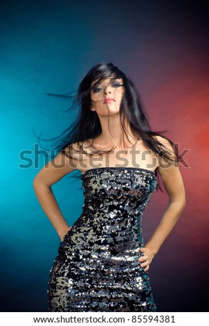 Pretty arrogant girl in a dress of sequins - stock photo
