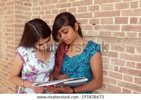 Pretty Asian college students studying. - stock photo