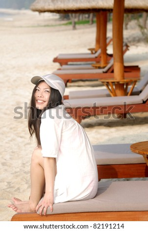 pretty asian girl relaxing at beach - stock photo