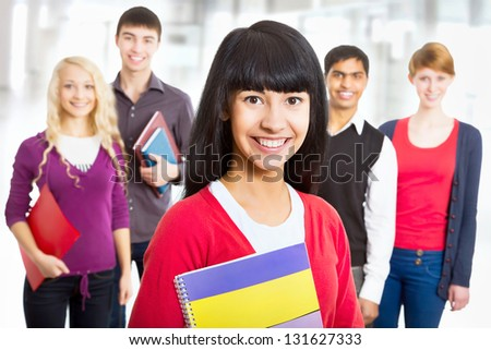 Pretty asian girl student and her diversity friends on background - stock photo