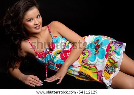 Pretty asian woman laying down - stock photo
