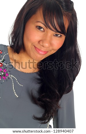 Pretty Asian woman model in action, on white background - stock photo