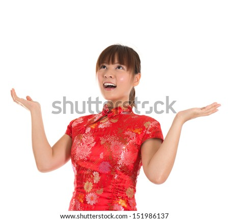 Pretty Asian woman with Chinese traditional dress cheongsam or qipao open arms looking up surprisingly. Chinese new year concept, female model isolated on white background. - stock photo