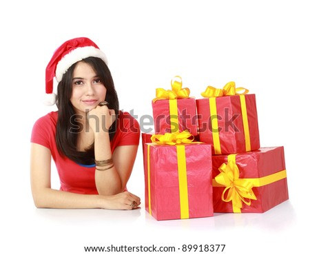 pretty attractive young girls smiling with a lot of christmas gift isolated on white background. - stock photo