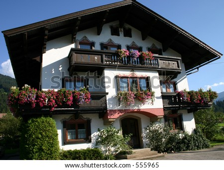 Pretty Austrian house in the village of Kirchberg - stock photo
