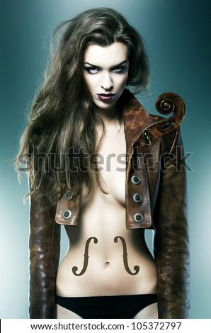 pretty beautiful erotic violin woman in brown jacket - stock photo