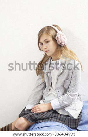 Pretty  beautiful girl with stress in earphone listening music - stock photo