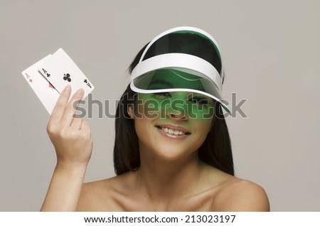 Pretty beautiful smiling young woman holding winning hand - stock photo