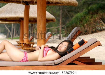 pretty bikini girl relaxing at beach - stock photo