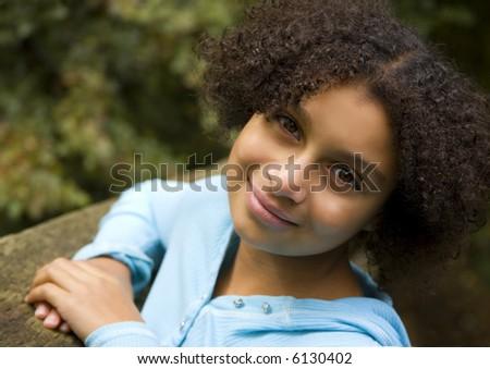 pretty biracial girl in an outdoor setting - stock photo