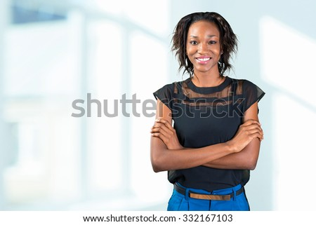Pretty black african woman standing - stock photo
